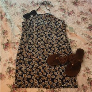 Backless spaghetti strap mini dress w/ daisy print
